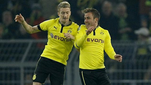 Mario Goetze (R) and Marco Reus of Borussia Dortmund celebrate Goetze's goal against Hanover (Reuters)