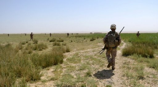 US Marines patrol with Afghanistan National Army (ANA) soldiers in Kalinoum village, west of Garmser, Helmand Province in June 2012. US lawmakers passed a sweeping $606 billion defense bill that exceeds a budget cap and faces a veto threat from the White House for failing to sufficiently rein in spending.