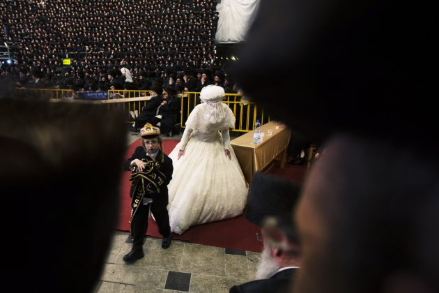 Ultra-Orthodox Jewish bride Penet finishes dancing with her relatives during a wedding ceremony in Jerusalem