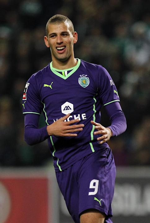 Sporting's Islam Slimani, from Algeria, reacts after missing a chance to score during the Portuguese league soccer match between Sporting and Nacional at the Alvalade stadium in Lisbon, Saturday,