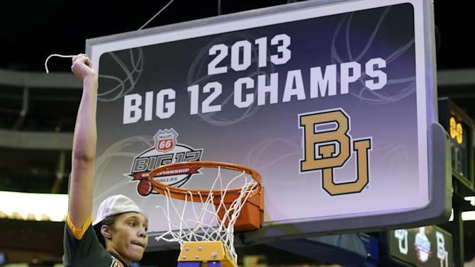Baylor center Brittney Griner (42) celebrates after cutting down part of the net following their NCAA college basketball championship game against Iowa State in the Big 12 Conference tournament, Monday, March 11, 2013, in Dallas. Baylor won 75-47. (AP Photo/Tony Gutierrez)