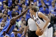 Oklahoma City Thunder forward Serge Ibaka, left defends Dallas Mavericks' Dirk Nowitzki during the first half of Game 3 in a first-round NBA basketball playoff series, Thursday, May 3, 2012, in Dallas. (AP Photo/Tony Gutierrez)