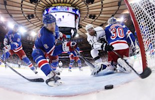 Rangers defenseman Anton Stralman reaches to save the puck from crossing the goal line as Kings center Jeff Carter tries to score in the first period ...