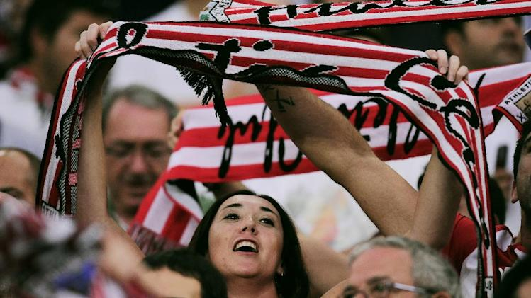 Athletic Bilbao's fan her cheers for the team during the match against SSC Napoli, during their Champions League playoff second leg soccer match, at San Mames stadium in Bilbao, northern Spain, Wednesday, Aug. 27, 2014. Athletic Bilbao won 3-1