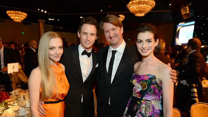 IMAGE DISTRIBUTED FOR THE PRODUCERS GUILD - From left, Amanda Seyfried, Eddie Redmayne, Tom Hooper and Anne Hathaway pose in the audience at the 24th Annual Producers Guild (PGA) Awards at the Beverly Hilton Hotel on Saturday Jan. 26, 2013, in Beverly Hills, Calif. (Photo by Jordan Strauss/Invision for Producers Guild/AP Images)