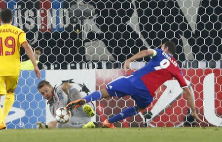 FC Basel's Streller scores a goal against Liverpool's goalkeeper Mignolet during their Champions League Group B match at St. Jakobs-Park stadium in Basel