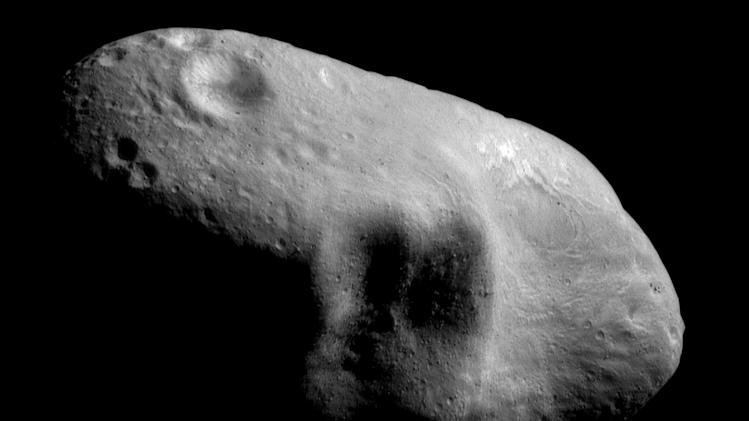 This March 3, 2000 image provided by NASA shows the near-Earth asteroid Eros from the NEAR spacecraft at a distance of 127 miles (204 kilometers).  A group of high-tech tycoons wants to mine nearby asteroids, hoping to turn science fiction into real profits. The mega-million dollar plan is to use commercially built robotic ships to squeeze rocket fuel and valuable minerals like platinum and gold out of the lifeless rocks that routinely whiz by Earth. One of the company founders predicts they could have their version of a space-based gas station up and running by 2020.  (AP Photo/NASA)