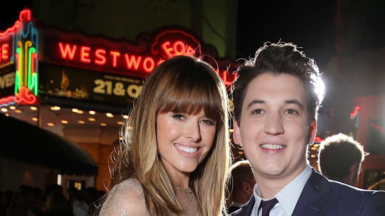 "Sarah Wright and Miles Teller at the LA premiere of ""21 and Over"" at the Westwood Village Theatre on Thursday, Feb. 21, 2013 in Los Angeles. (Photo by Eric Charbonneau/Invision/AP)"