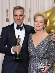 Daniel Day-Lewis, with his award for best actor in a leading role for &quot;Lincoln&quot;, left, and presenter Meryl Streep pose during the Oscars at the Dolby Theatre on Sunday Feb. 24, 2013, in Los Angeles. (Photo by John Shearer/Invision/AP)