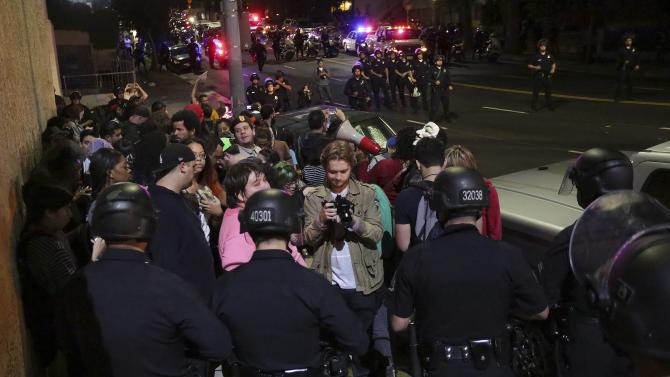A group of protesters is detained before being released with a warning by the LAPD during a demonstration in Los Angeles