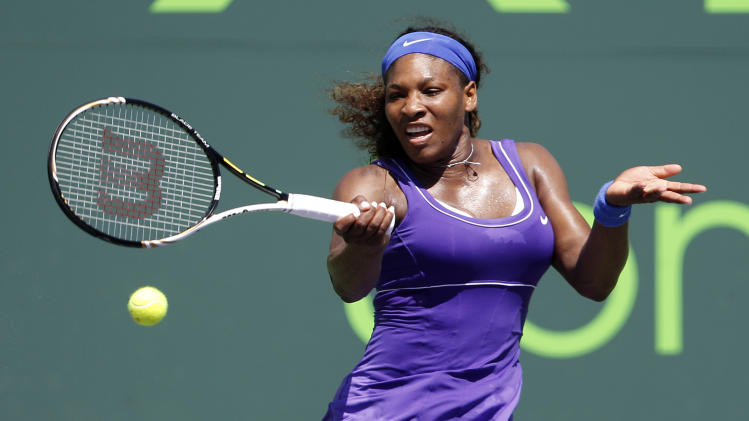 Serena Williams returns the ball to Roberta Vinci of Italy, during the Sony Ericsson Open tennis tournament, Saturday, March 24, 2012, in Key Biscayne, Fla. Williams won the match 6-2, 6-1. (AP Photo/Lynne Sladky)