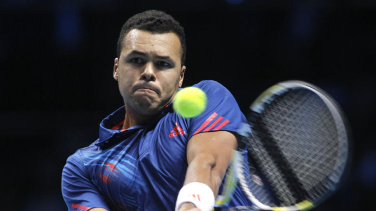 Jo-Wilfried Tsonga of France plays a return to Andy Murray of Britain during their singles tennis match at the ATP World Tour Finals in London Friday, Nov. 9, 2012. (AP Photo/Sang Tan)