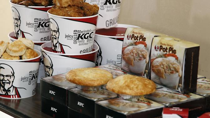 KFC food is served at the event for Jo Anne Yeager Sallah, a relief worker stationed in Gambia with her husband and children, surprises her father, Capt. Donald Yeager with their return in Sunnyvale, Calif., Wednesday, March 28, 2012. This reunion, coordinated by KFC, is part of chain's goal to bring friends and family together in 2012. (Tony Avelar/AP Images for KFC)
