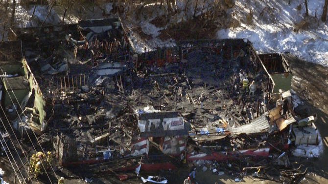 FILE - In this Feb. 20, 2003 aerial file photo, authorities continue their work at The Station nightclub where more than 100 people died in a late night fire, in West Warwick, R.I. A fire that swept through a crowded nightclub in southern Brazil early Sunday, Jan. 27, 2013, and killed more than 230 people appears to be the deadliest in more a decade. Witnesses said a flare or firework lit by band members may have started the blaze. Similar circumstances led to the the 2003 West Warwick, R.I., fire, where pyrotechnics used as a stage prop by the 1980s rock band Great White set ablaze cheap soundproofing foam on the walls and ceiling of the music venue. (AP Photo/ Robert E. Klein, File)