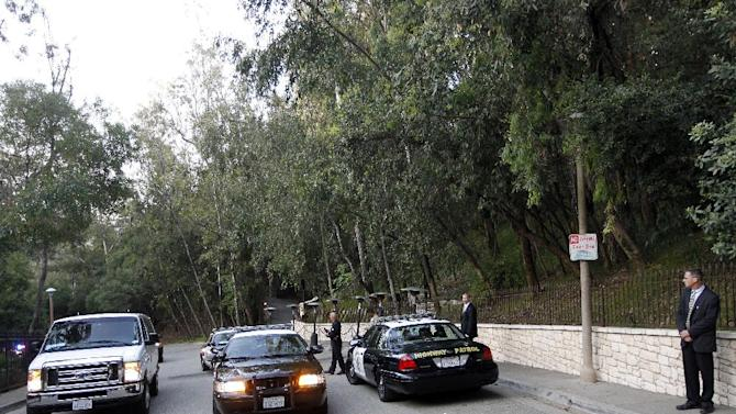 Law enforcement vehicles are parked outside the home of actor George Clooney, the site of a private fundraiser for President Barack Obama, Thursday, May 10, 2012, in Los Angeles. One hundred and fifty supporters will dine with Obama at Clooney's home, at a party organizers expect to gross $15 million for the President's re-election campaign. (AP Photo/Pablo Martinez Monsivais)
