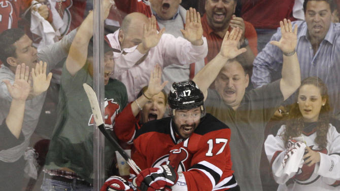 New Jersey Devils' Ilya Kovalchuk, of Russia, celebrates in front of fans after scoring a goal during the first period of Game 6 of the NHL hockey Stanley Cup Eastern Conference finals against the New York Rangers on Friday, May 25, 2012, in Newark, N.J. (AP Photo/Frank Franklin II)