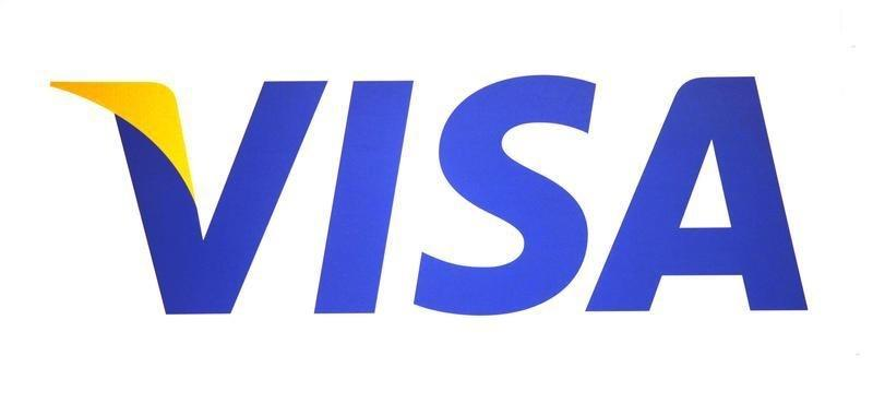 Cheaper gasoline helps Visa report better-than-expected profit