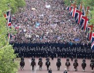 Police form a line as crowds watch Queen Elizabeth and the Royal family from the Mall during the Diamond Jubilee celebrations in London