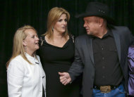 Mary Chapin Carpenter, left, talks with Garth Brooks, right, and Trisha Yearwood before the Nashville Songwriters Hall of Fame inductions on Sunday, Oct. 7, 2012, in Nashville, Tenn. Carpenter is one of the inductees. (AP Photo/Mark Humphrey)