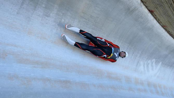 Kristers Aparjods of Latvia competes during the Men's Luge Singles at the Lillehammer Olympic Sliding Center during the Winter Youth Olympic Games, Lillehammer Norway, Sunday Feb. 14, 2016. (Thomas Lovelock /IOC via AP)