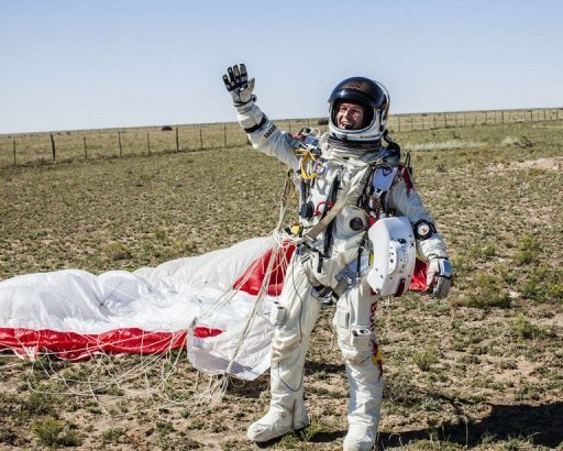 Felix Baumgartner of Austria celebrates after successfully completing his jump from the edge of space for Red Bull Stratos in Roswell, New Mexico, in this photo provided by www.redbullcontentpool.com. Baumgartner became the first man to break the sound barrier in a record-shattering, death-defying freefall jump