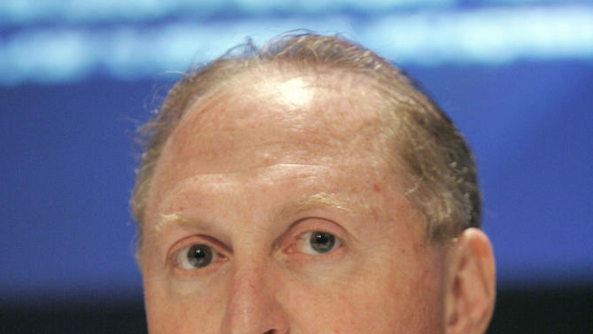 FILE - In this Oct. 19. 2007 file photo, News Corp. CFO David F. DeVoe is shown during a news conference following the News Corp. annual meeting, in New York. (AP Photo/Richard Drew, file)