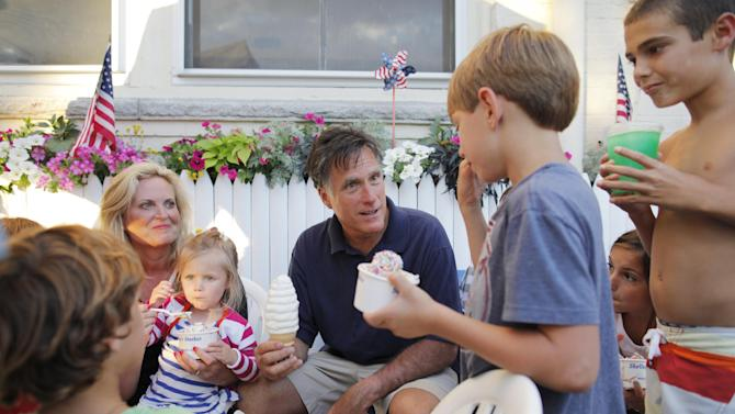 Republican presidential candidate Mitt Romney, center, and his wife Ann, left, have Bailey's Bubble ice cream in Wolfeboro, N.H., Monday, July 2, 2012, as they continue their vacation from the campaign trail. (AP Photo/Charles Dharapak)