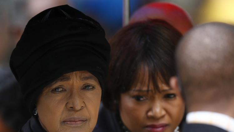 Winnie Mandela and daughter Zindzi arrive for official memorial service for Nelson Mandela in Johannesburg