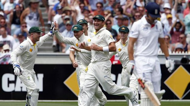 Australia's captain Michael Clarke (2nd R) celebrates with teammates after he caught England's captain Alastair Cook (Reuters)