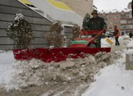 A street cleaner using a motorized snow plough cleans the sidewalk in the Kosovo capital, Pristina, on Tuesday, Dec. 11, 2012. Weather forecasts predict cold temperatures and snow for Eastern Europe during the upcoming days. (AP Photo/Visar Kryeziu )