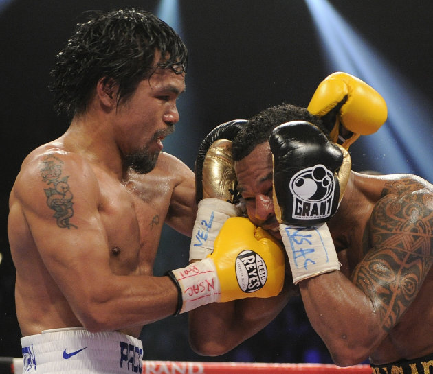 Manny Pacquiao, left, lands a punch against Shane Mosley in the seventh round during a WBO welterweight title bout, Saturday, May 7, 2011, in Las Vegas.  (AP Photo/Mark Terrill)