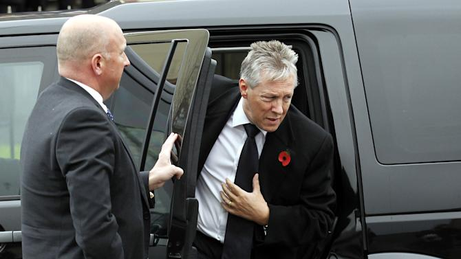 Northern Ireland First Minister Peter Robinson, right, arrives for the funeral of murdered prison officer David Black at Molesworth Presbyterian Church in Cookstown, Northern Ireland, Tuesday, Nov. 6, 2012. Mourners gather for the funeral of a Northern Ireland prison officer slain by Irish Republican Army die-hards, the first killing of a guard in nearly two decades. No group has claimed responsibility for last week's killing of 52-year-old David Black, who was shot from a passing car as he drove to work at Northern Ireland's main prison.   (AP Photo/Peter Morrison