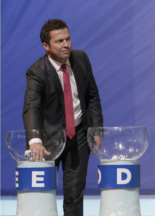 Matthaus draws a ball from the pot during the draw for the 2014 World Cup in Sao Joao da Mata