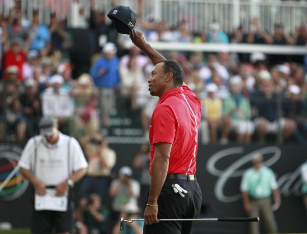 Tiger Woods reacts after his final putt on the 18th green during final round play in the 2013 WGC-Cadillac Championship PGA golf tournament in Doral, Florida March 10, 2013. REUTERS/Joe Skipper (UNITED STATES  - Tags: SPORT GOLF)