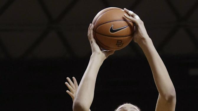 Baylor center Brittney Griner (42) shoots against Kansas State guard Heidi Brown (10) during the first half of an NCAA college basketball game Monday, March 4, 2013, in Arlington, Texas. (AP Photo/LM Otero)