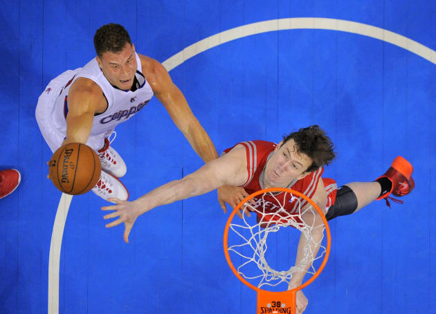 Los Angeles Clippers forward Blake Griffin, left, puts up a shot as Houston Rockets center Omer Asik, of Turkey, defends during the first half of an NBA basketball game, Wednesday, Feb. 26, 2014, in L