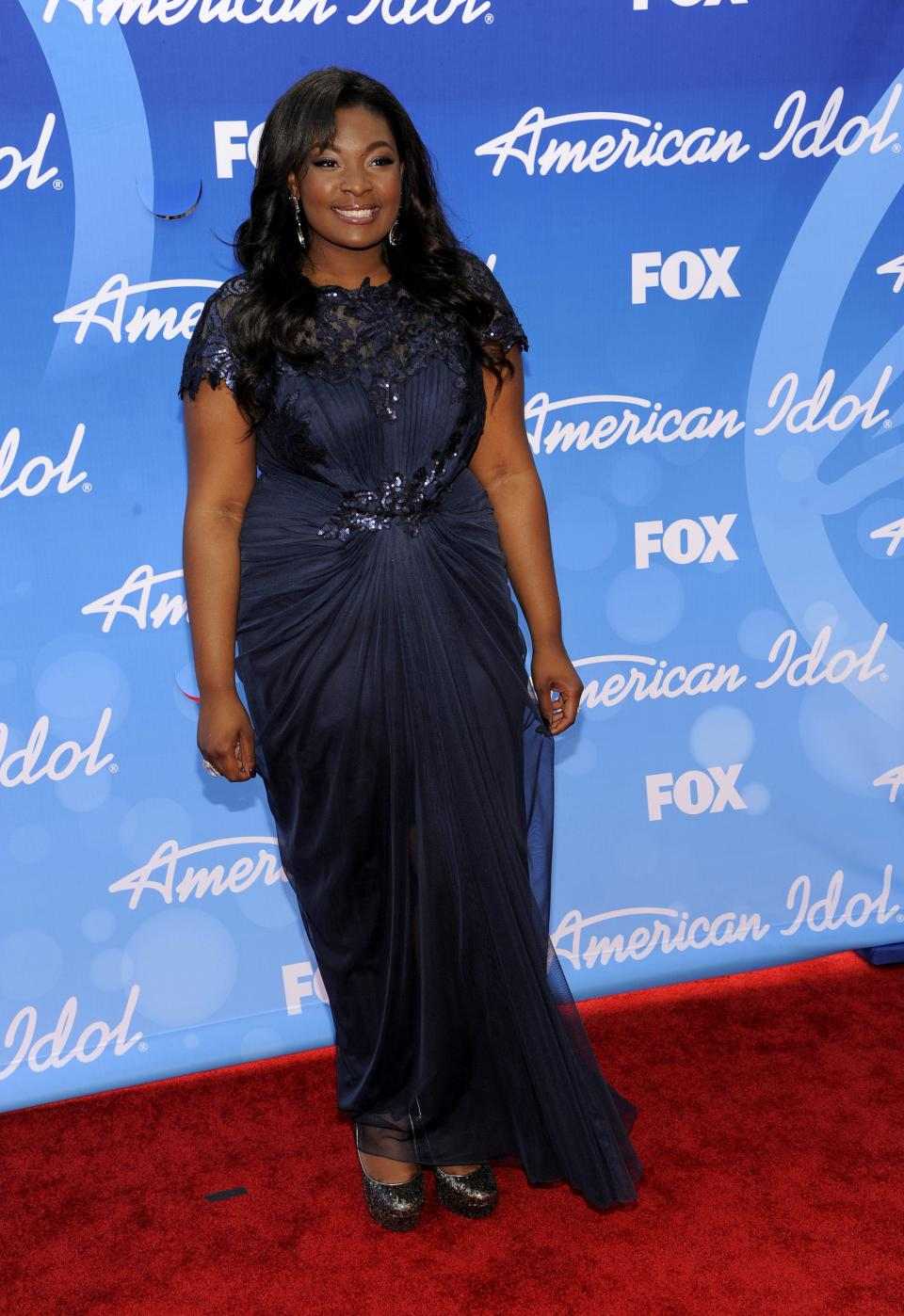 "Candice Glover arrives at the ""American Idol"" finale at the Nokia Theatre at L.A. Live on Thursday, May 16, 2013, in Los Angeles. (Photo by Chris Pizzello/Invision/AP)"