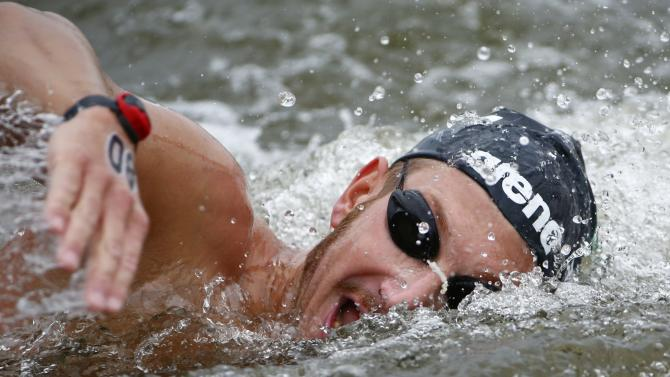 Italy's Ruffini swims to win the gold medal in the men's 25km open water race at the 16th FINA World Championships in Kazan