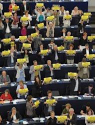 Members of the European parliament hold up placards reading &quot;Hello democracy, goodbye ACTA&quot; as they vote to throw out threw out the controversial global pact to battle counterfeiting and online piracy, quashing any EU ratification and possibly killing it for good