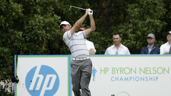 Charl Schwartzel, of South Africa, follows his shot off the fifth tee during the first round of the Byron Nelson Championship golf tournament Thursday, May 16, 2013, in Irving, Texas. Schwartzel finished the round at 7-under par 63. (AP Photo/Tony Gutierrez)
