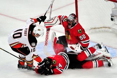 Watch Corey Crawford try to chop a Ducks player in half