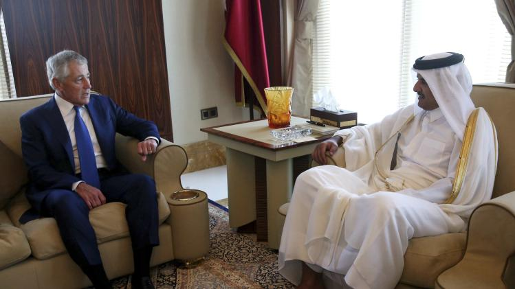 U.S. Secretary of Defense Hagel meets with Qatar's Emir Sheikh Tamim in Doha