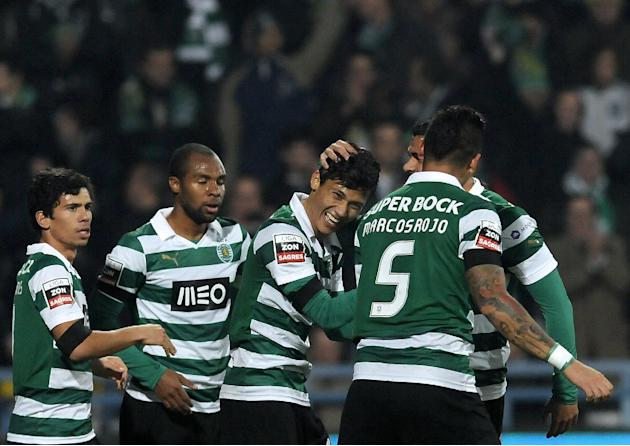 Sporting's Andre Martins, Wilson Eduardo, Fredy Montero from Colombia, Marcos Rojo from Argentina and Mauricio Nascimento from Brazil, from left, celebrate the opening goal against Gil Vicente in