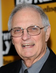 "FILE- In this April 19, 2012, file photo, actor Alan Alda attends a screening at the Museum of Modern Art in New York. Alda, the host of of PBS's ""Scientific American Frontiers,"" and a founder of the Center for Communicating Science at Stony Brook University, is sponsoring an international contest for scientists, asking them to explain in terms a sixth-grader could understand: ""What is time?"" (AP Photo/Evan Agostini, File)"
