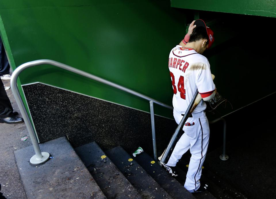 Washington Nationals' Bryce Harper heads to the clubhouse after Game 3 of the National League division baseball series against the St. Louis Cardinals on Wednesday, Oct. 10, 2012, in Washington. St. Louis won 8-0. (AP Photo/Alex Brandon)