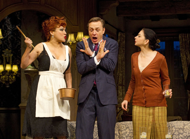 In this theater image released by Boneau/Bryan-Brown, Jennifer Tilly, left, Ben Daniels, center, and Spencer Kayden are shown in a scene from the Roundabout Theatre Company&#39;s &quot;Don&#39;t Dress for Dinner,&quot; in New York. (AP Photo/Boneau/Bryan-Brown, Joan Marcus)