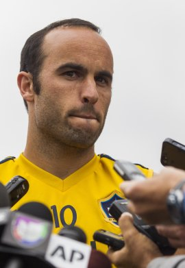Landon Donovan talks to the media after a training session. (AP)