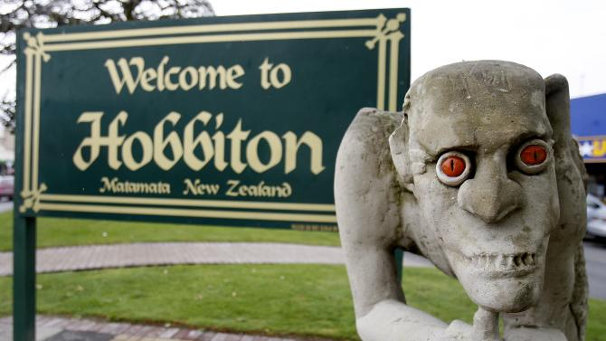 """In this photo taken June 28, 2010, a sculpture of Gollum, the villainous """"Lord of the Rings"""" hobbit, stands in front of a welcome sign, in Hobbiton Town, Matamata, New Zealand.  New Zealand may lose the filming of """"The Hobbit"""" movies, with financial backers Warner Brothers making arrangements to shift the production offshore after a stalemate between director Peter Jackson's production company, Wingnut Films, and the union Actors' Equity  over pay deals for actors in the New Zealand 660 million dollar (US$500 million) two-film prequel to the highly successful """"Lord of the Rings"""" trilogy.  (AP Photo/New Zealand Herald, Christine Cornege)** NEW ZEALAND OUT FAIRFAX OUT**"""