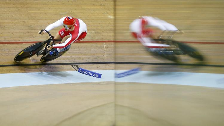 Jason Kenny of England rides in the qualifying round of men's sprint at 2014 Commonwealth Games at the Chris Hoy velodrome in Glasgow, Scotland