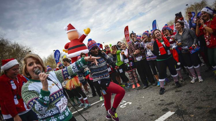 Jaime Padgett of Centreville, Virginia sings karaoke during the Ugly Sweater Run in Maryland